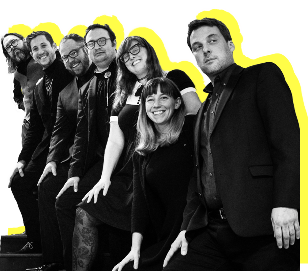 Band photo of all musicians on staircase